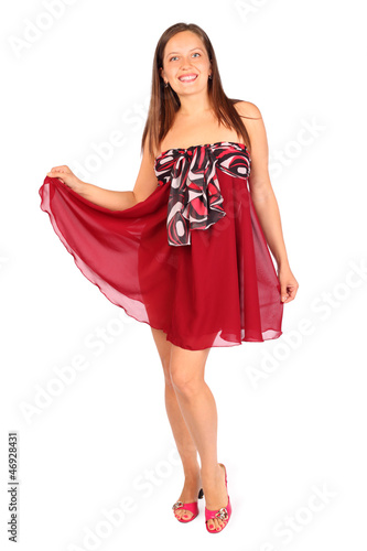 Beautiful young woman dressed in red pareo poses in studio