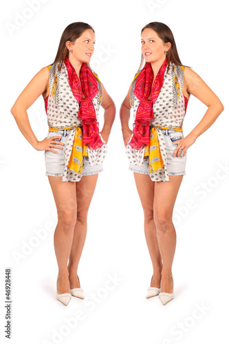 Two same women in studio on white background.