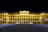Facade of Schonbrunn Palace at dark winter night in Vienna