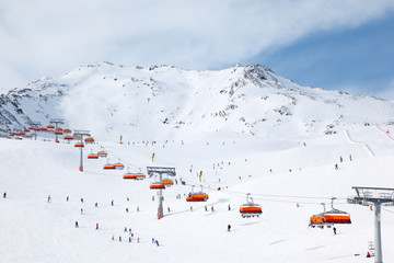 Cable car in mountains. Many skiers ride in Alps at winter