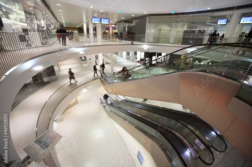 Escalator and people at three floors in shopping center