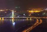 Liede Bridge, road, ship at night in Guangzhou, China