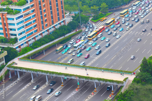 road with overhead crossing, cars, busses in Guangzhou