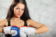Sexy girl in boxing gloves pose, half body
