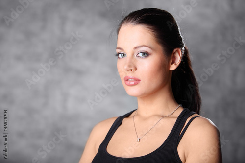 Portrait of beautiful brunette girl in shirt in photo studio