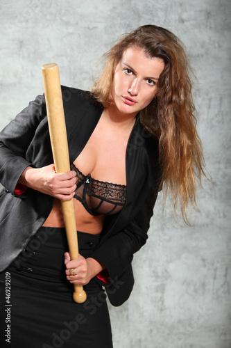 Beautiful girl in coat pose, hold bat photo studio, half body