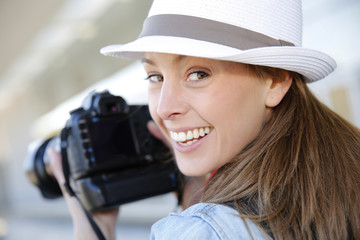 Smiling photographer with hat doing photo session