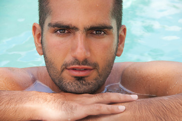 Wet Beauty .Handsome man portrait in water