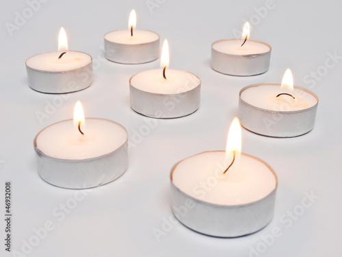 Leinwandbild Motiv 7 brennende Teelichter