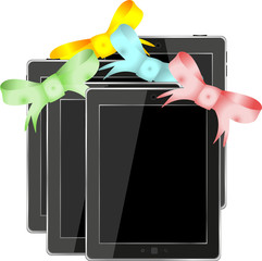 Tablet pc set with ribbons and bow isolated on a white