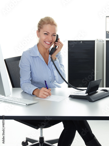 Young woman is having a good call in business