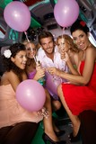 Beautiful girls having party in limo