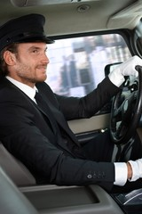 Elegant chauffeur driving luxurious car