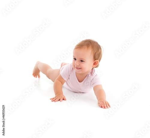 Impish little girl rolling on floor
