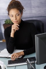 Young businesswoman working on computer