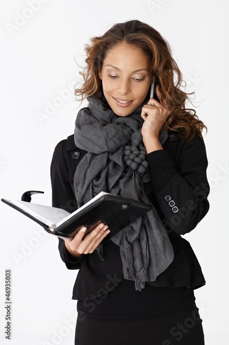 Young businesswoman on phone smiling