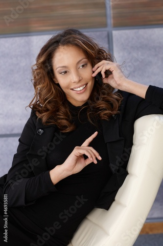 Attractive businesswoman on phone call smiling