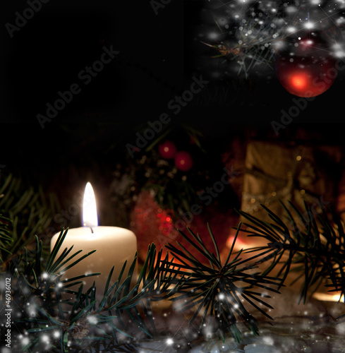 Christmas still life with snow candles and christmas decorations