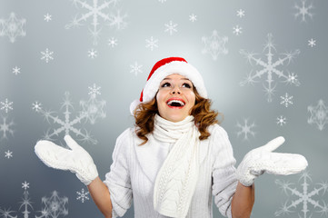 Happy young woman in Santa hat