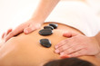 Beautiful woman getting spa massage with stones