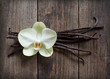 Vanilla sticks and flower on the wood background