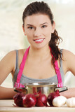 Young woman cooking healthy food