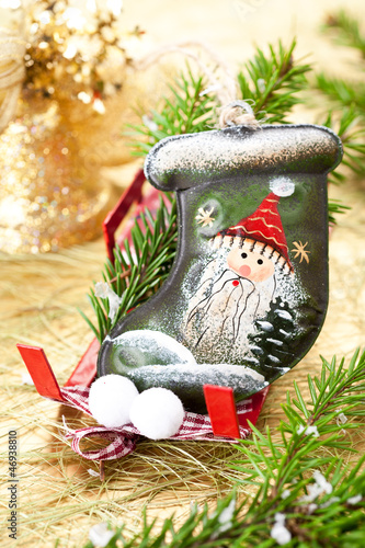 Stocking Santa Claus on Christmas sleigh. Christmas decoration.