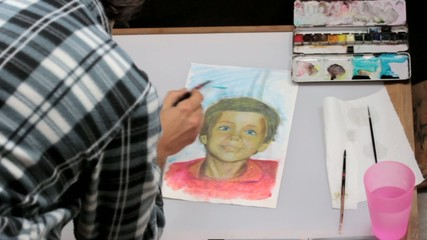 artist working on a portrait
