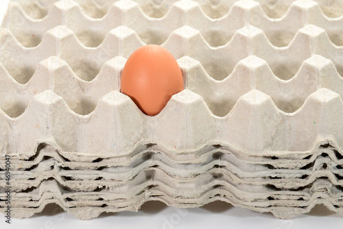Egg On A Stack Of Egg Trays