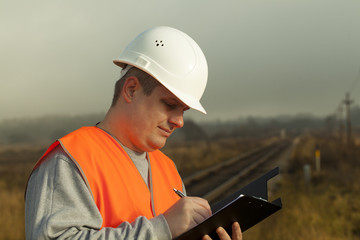 Railroad employee with a folder