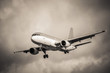 sepia toned aircraft landing in turbulence