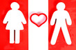 Male and female figure with heart between them
