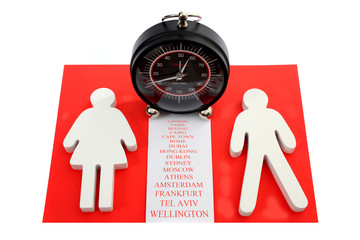 Male and female figure with major city names en terminal clock
