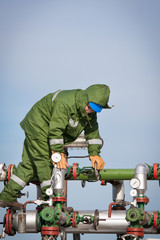 The worker of the oil and gas refinery