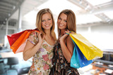 Two Beautiful Young Women in a Mall