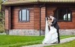 Wedding couple in front of big house in a park