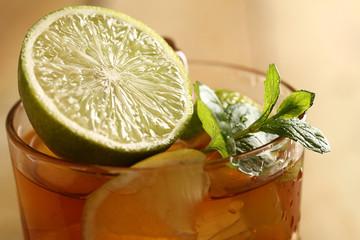 Fresh cold tea with lime, mint and lemon
