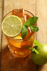 Fresh cold tea with lime, mint and lemon