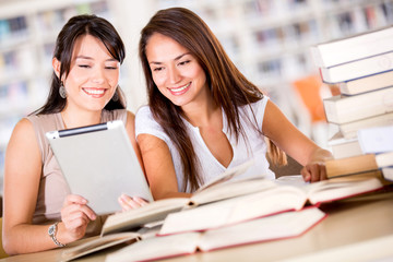 Women at the library with a e-book reader