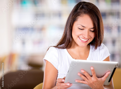 Woman reading on an e-book reader