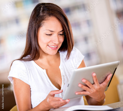 Woman reading on a tablet computer