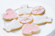 many pink cookies on a white plate