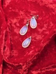 Woman's jewelry set on red velvet background, close-up