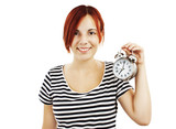 Young beautiful woman with the clock on white background