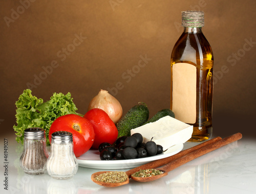 Ingredients for a Greek salad on brown background close-up