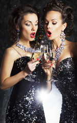 Cheerful women toasting at party with wineglasses celebrating