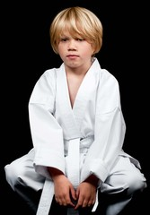 Karate kid sitting