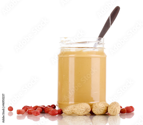 Delicious peanut butter in jar isolated on white