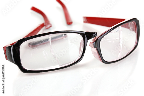 Broken glasses isolated on white