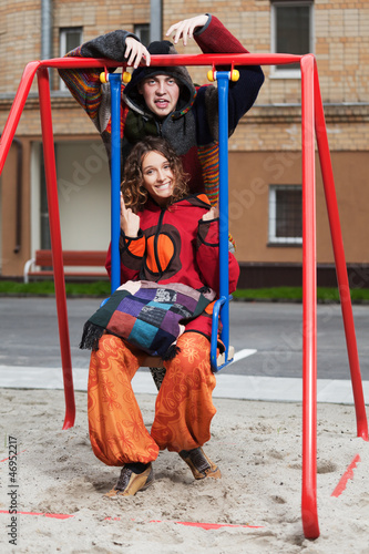 Happy young couple on the swing